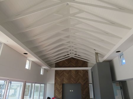 Cape Roof - Exposed Scissor Trusses and Isoboard Ceiling