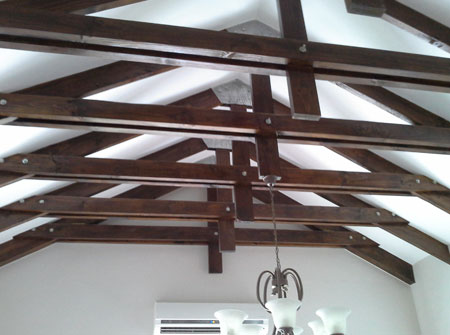 Cape Roof - Bolted Chapel Trusses Stained