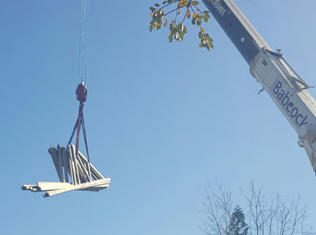 Cape Roof - Lifting Trusses with Crane to Multi Storey Building